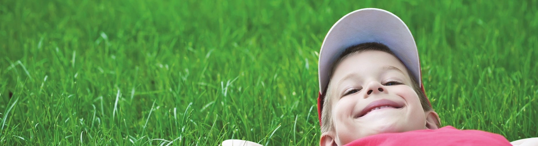 Smart Irrigation Month - Boy in Grass